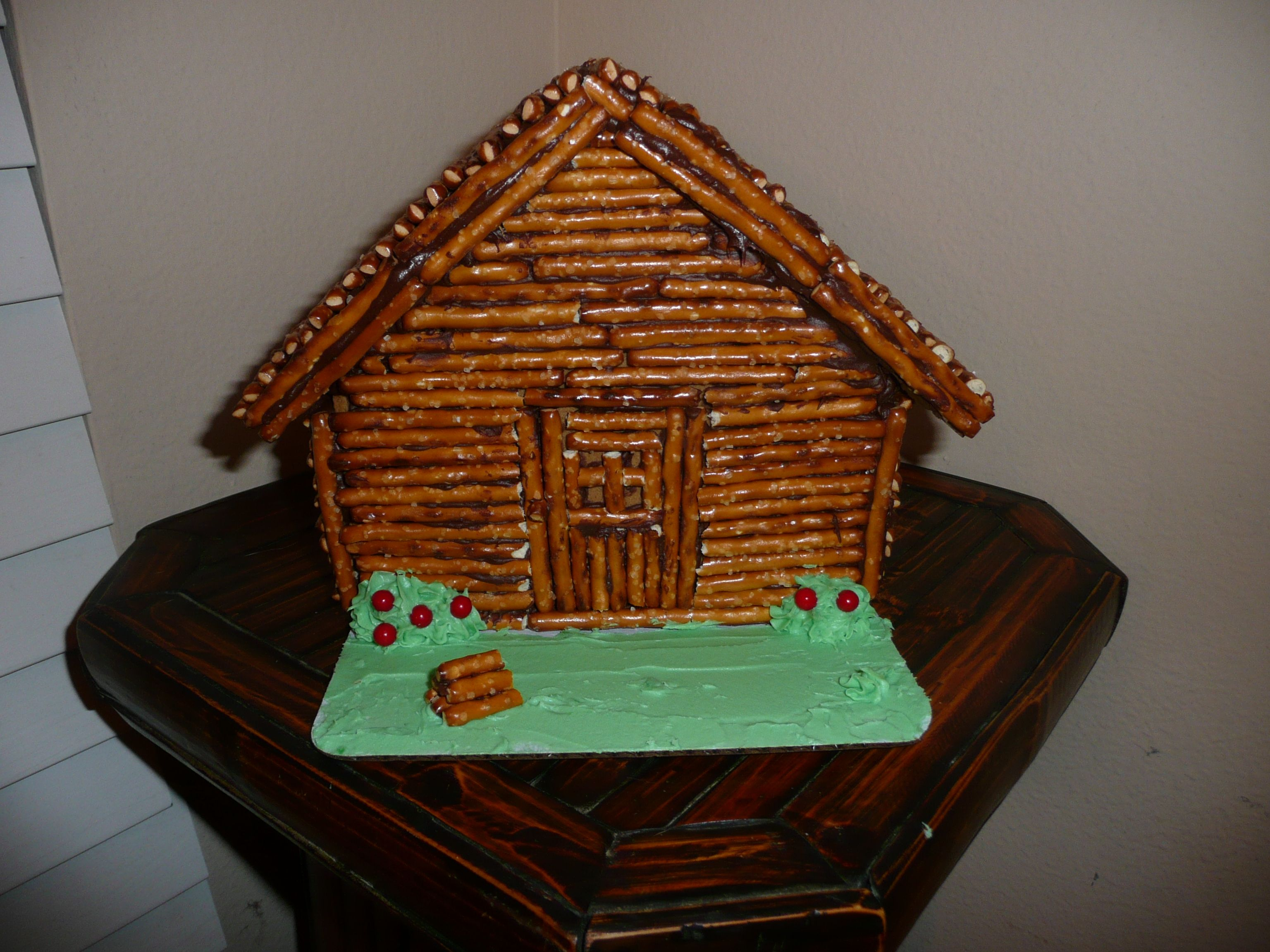 Abraham Lincoln Log Cabin, Made From Gingerbread House (After Christmas  Clearance) + Pretzel Sticks And Chocolate Frosting.