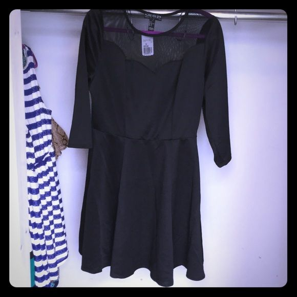 Black Dress- Forever 21 Black dress from Forever 21. Never worn and tags are still attached. The dress is mid length and comes down to right above the knee cap. The top of the dress has a sheer design as well as the back. Forever 21 Dresses Midi