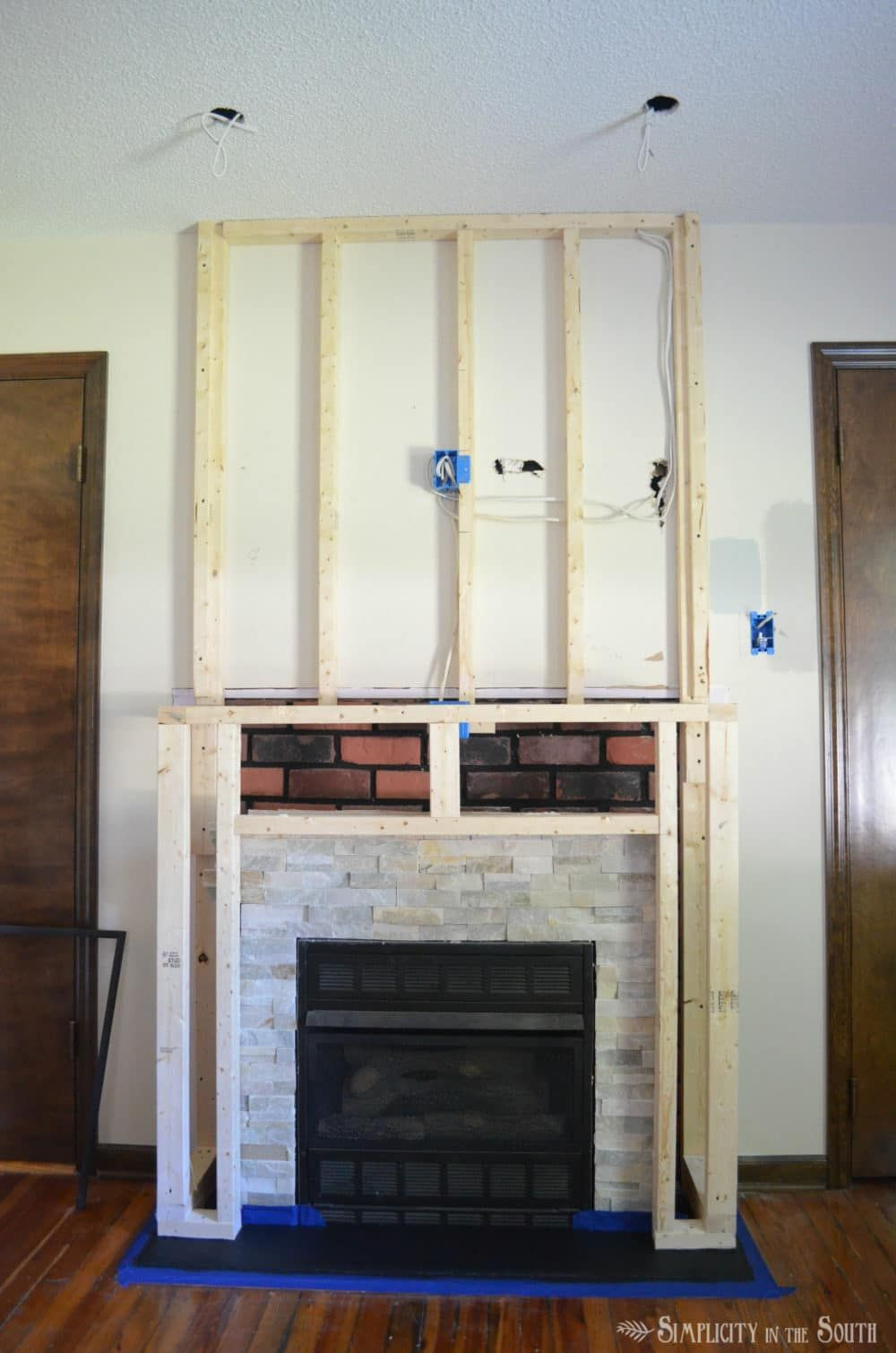 DIY Budget Fireplace Surround Makeover From the Boring