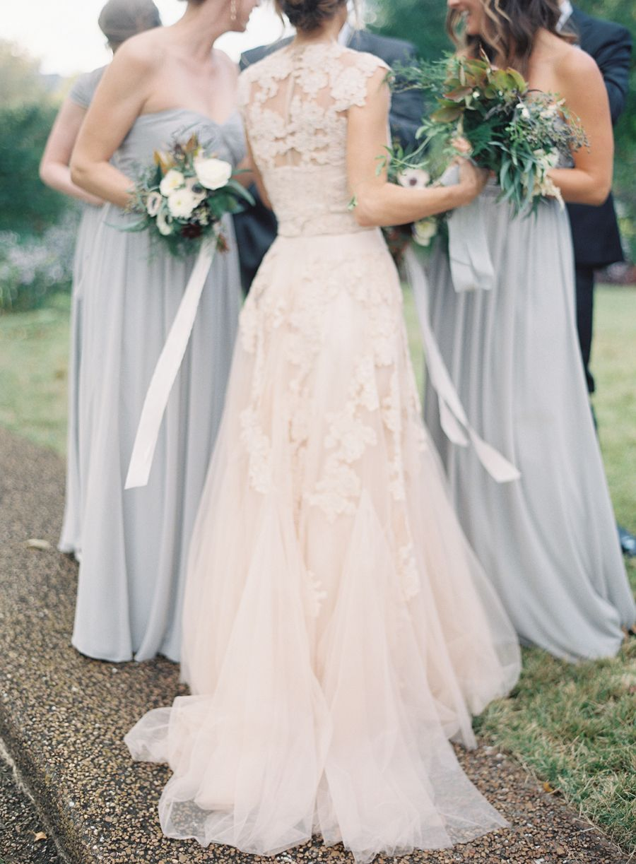 Blush wedding dress by reem acra and bridesmaid dresses in pale