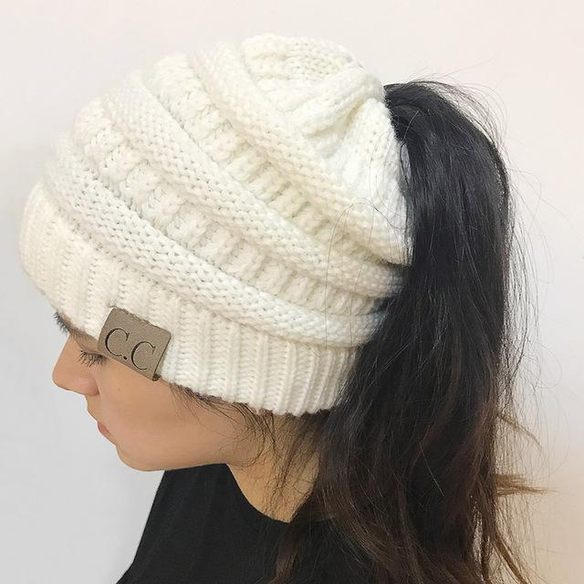 2018 CC Warm Winter Hat For Women Ponytail Beanie Stretch Cable Knit Messy  Bun Hats Soft 827c99e3c7d