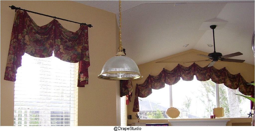 Tie kitchen and Family Room together with same valance design. drapestudio.com