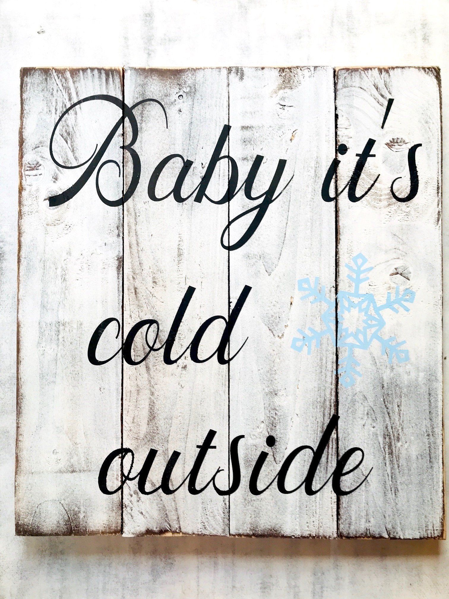 Farmhouse Christmas Decor Wood Sign  Baby it's Cold Outside is part of Winter decor Signs - 2 inch  Please note Wood will vary in size, color and will have imperfections  lots of CHARACTER! The wood sign may also have knots, holes where knots have fallen out, different grains which can cause the color to very slightly all giving it a great personal and unique rustic touch! SHIPPING for Wood Signs We use USPS 23 day priority shipping for most of my signs  We normally ship all orders on FRIDAY'S unless you have purchased the RUSH OPTION  Thank you for your understanding  We love making our rustic home decor signs! We want you to be happy and to order again in the future for your next big event, birthday, or holiday  Our wood signs make the PERFECT gift for all your family and friends  Our goal is to gain friends instead of followers and would love for you to join me on this journey by visiting us on our social media platforms, which are linked at the bottom    ATTENTION Please look over the shipping policies and time frame for your wood sign to be shipped BEFORE ordering  Each wood sign is custom built and hand painted when ordered and is completed in the order that we receive them  We understand you may need lastminute gifts or home decor items so if you require your order to ship within 3 days upon date of purchase you can RUSH your order  The RUSH option is an additional $30  Which can be purchased here  (please be aware this is not FASTER shipping, this purchase is to jump it up in line in front all my other orders and to ship from my location quicker, this is not for quicker shipping timeframe)  PLEASE take a moment to share with your family and friends! Hit the share it buttons below, Facebook, Pinterest, or Instagram one share or mention or share will go a long way, thank you!! Red Roan Signs Copyright @ Red Roan Signs 2014  Rustic Farmhouse Custom Wood Signs