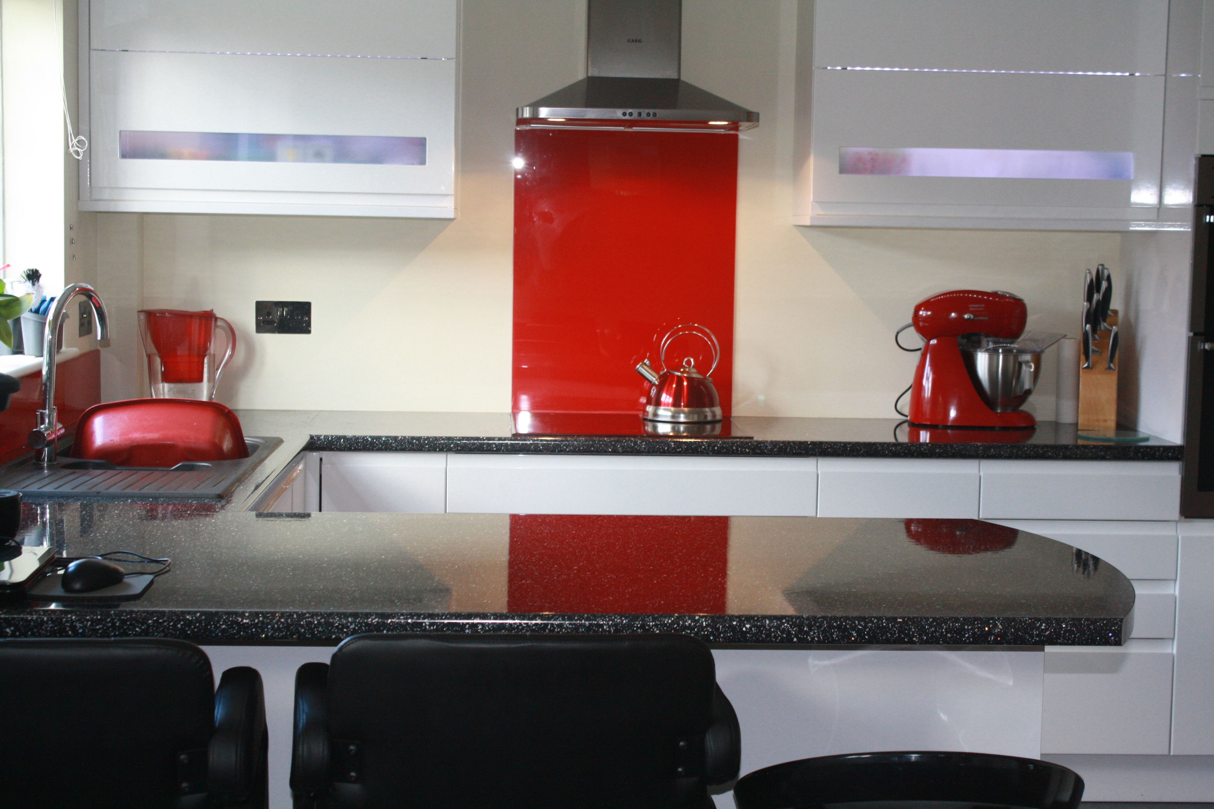 A Bright Red Acrylic Kitchen Splashback With A High Gloss