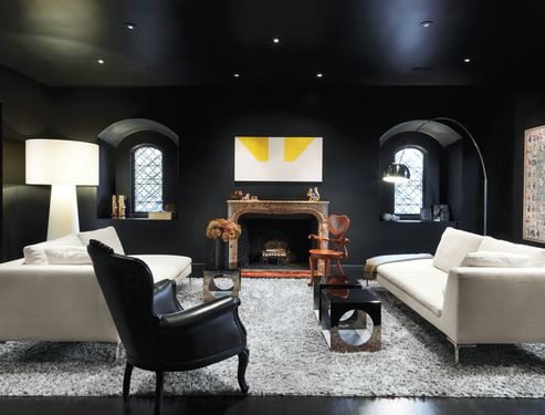 Baroque Interior meets modern in San Francisco.  Turin embraced the dark in her striking living room—the deep paint is Le Corbusier's 4320J from Les Couleurs Suisse. An iconic Arco lamp by Achille and Pier Giacomo Castiglioni for Flos, Charles sofas by Antonio Citterio for B Italia, an Extra Big Shadow floor lamp by Marcel Wanders for Cappellini, and a painting over the mantel by Martin Barré shed a little light