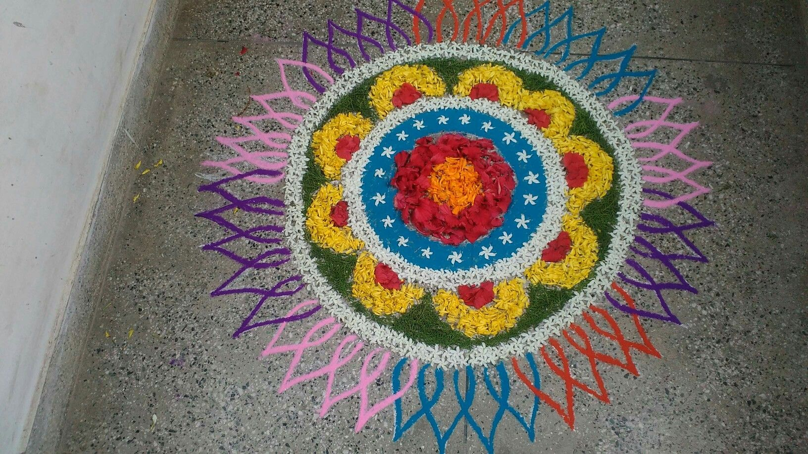 Fusion rangoli made with colours and flowers, made by me