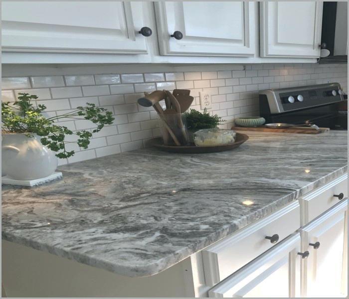 Fantasy Brown Leathered Granite Glass Subway Tile In Taupe Against Fantasy B Cheap Kitchen Countertops Kitchen Remodel Countertops Farmhouse Kitchen Backsplash