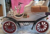 """FREE-SHIPPING- GREAT VINTAGE ASI AMERETTO 1976 IN A CADILLAC 1903 SHAPE ,IVORY WHITE WITH RED AND GOLD DETAILING.ITS 11""""X 6-1/2 X 4-1/2 IN MINT CONDITION I DONT HAVE BOX ITS STILL FULL AND SEALED UNOPEN.NO ONE UNDER THE AGE OF 21 CAN BUY THIS ITEM..."""