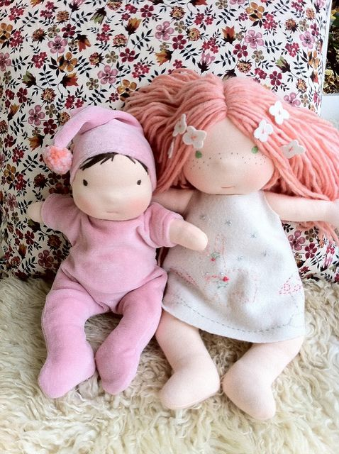 Waldorf dolls.  That tiny baby is so cute.  I need to make one soon.