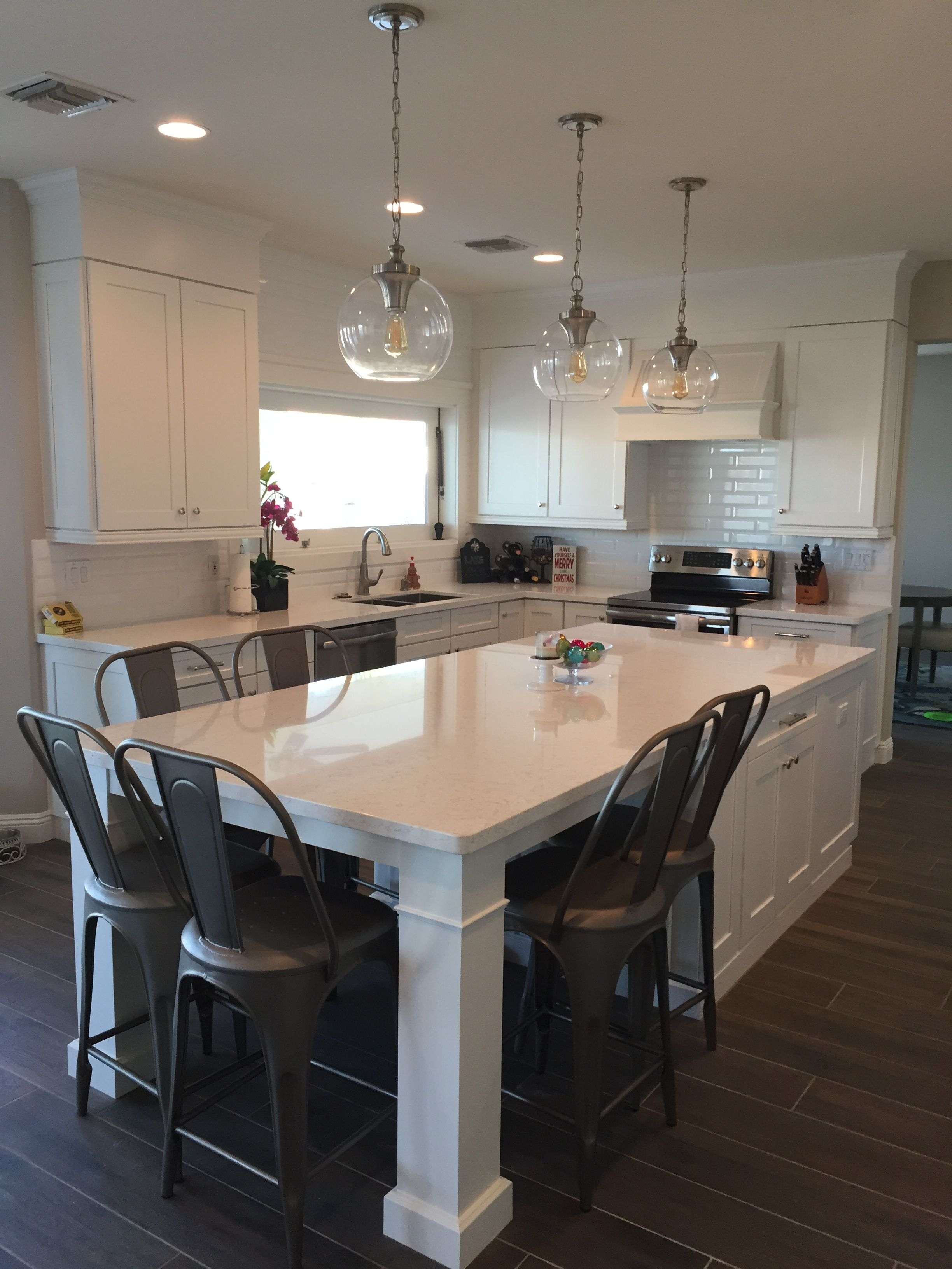 White shaker waypoint cabinets designed by nathan hoffman for Large kitchen island ideas with seating