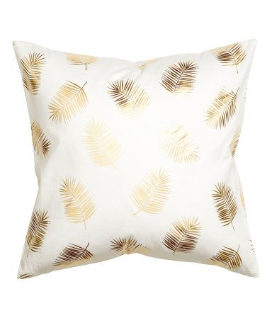 White/gold-colored. Cushion cover in cotton twill with a shimmery, printed leaf pattern and concealed zip.