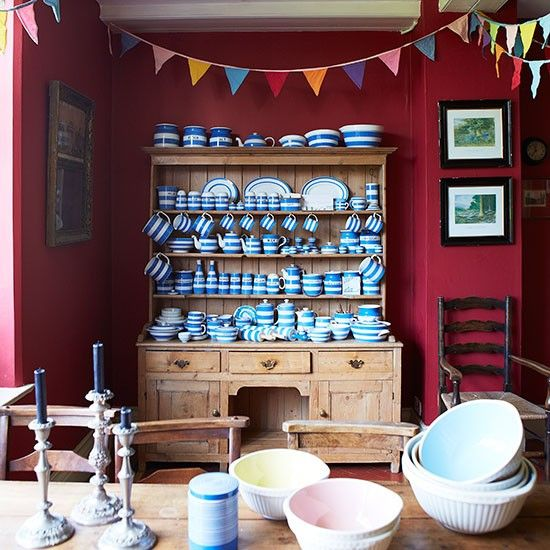 Deep Red Dining Room With Adorable Blue Striped Vintage Cornishwear On A Rustic Dresser And Hutch