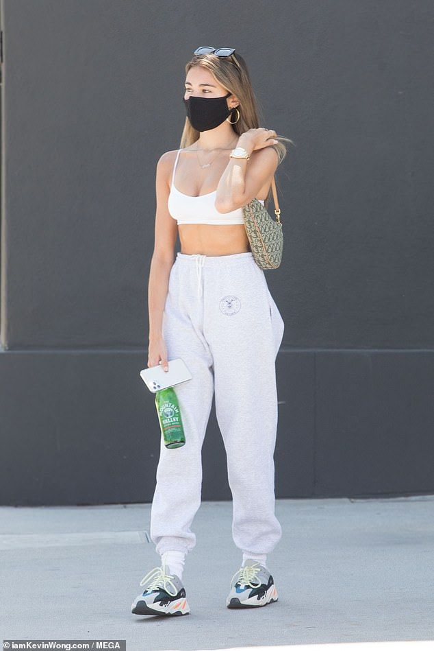 Madison Beer displays her taut waist in a tiny sports bra – celebrity street style