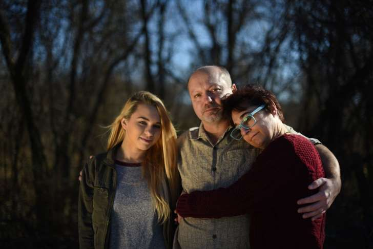 Charlotte Zaremba's family — sister Audrey, left, father Jim, center, and mother Suzanne, stand outside their Ellicott City, Md., home, where the 16-year-old was shot to death by a high school classmate on New Year's Day.