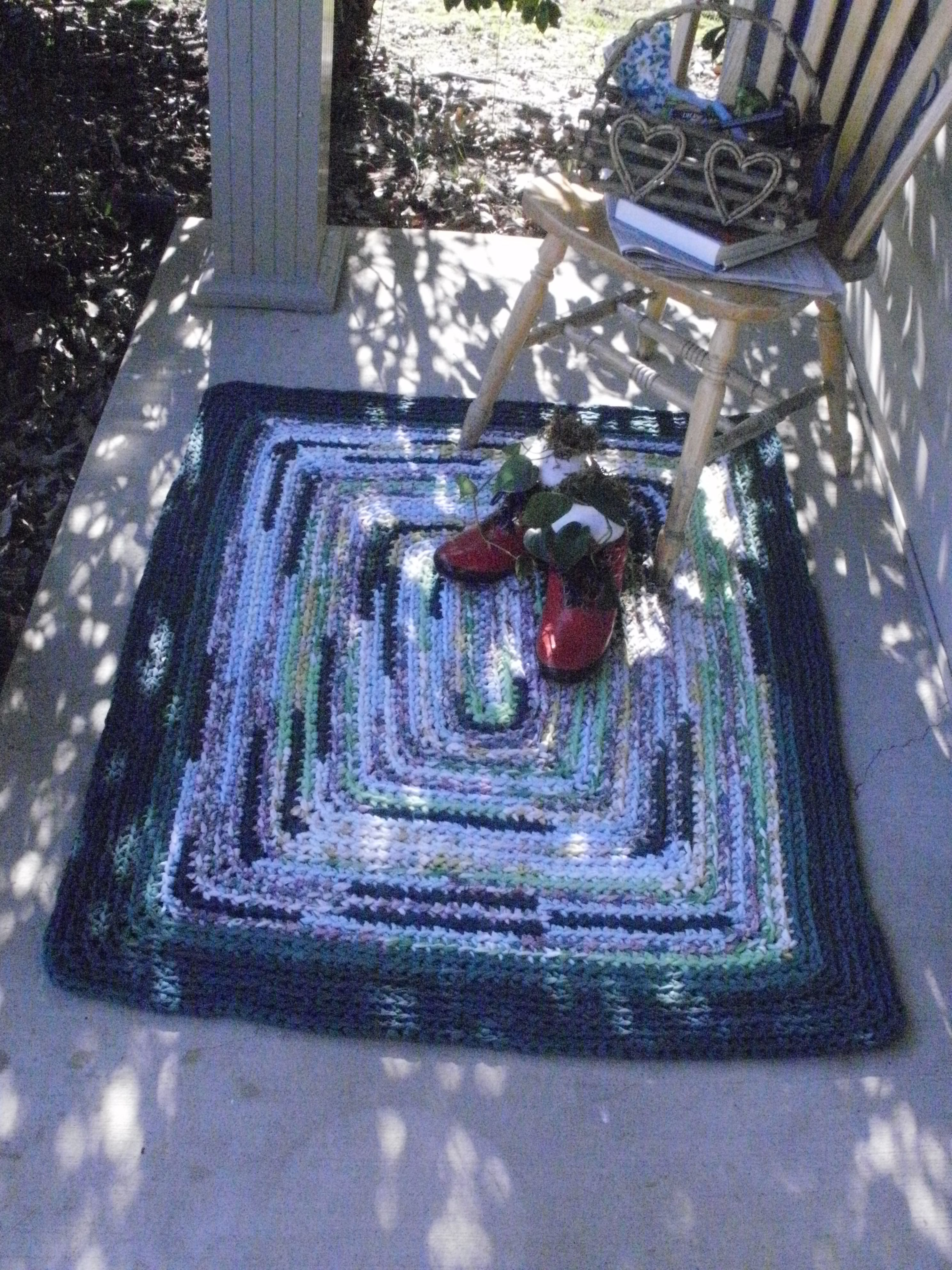 This spring I crocheted this rug using  worn sheets, filled some red boots with plants for a new look to my front porch.  If you would like the pattern to this rug, email me at  ourcreativecrochet@gmail.com.