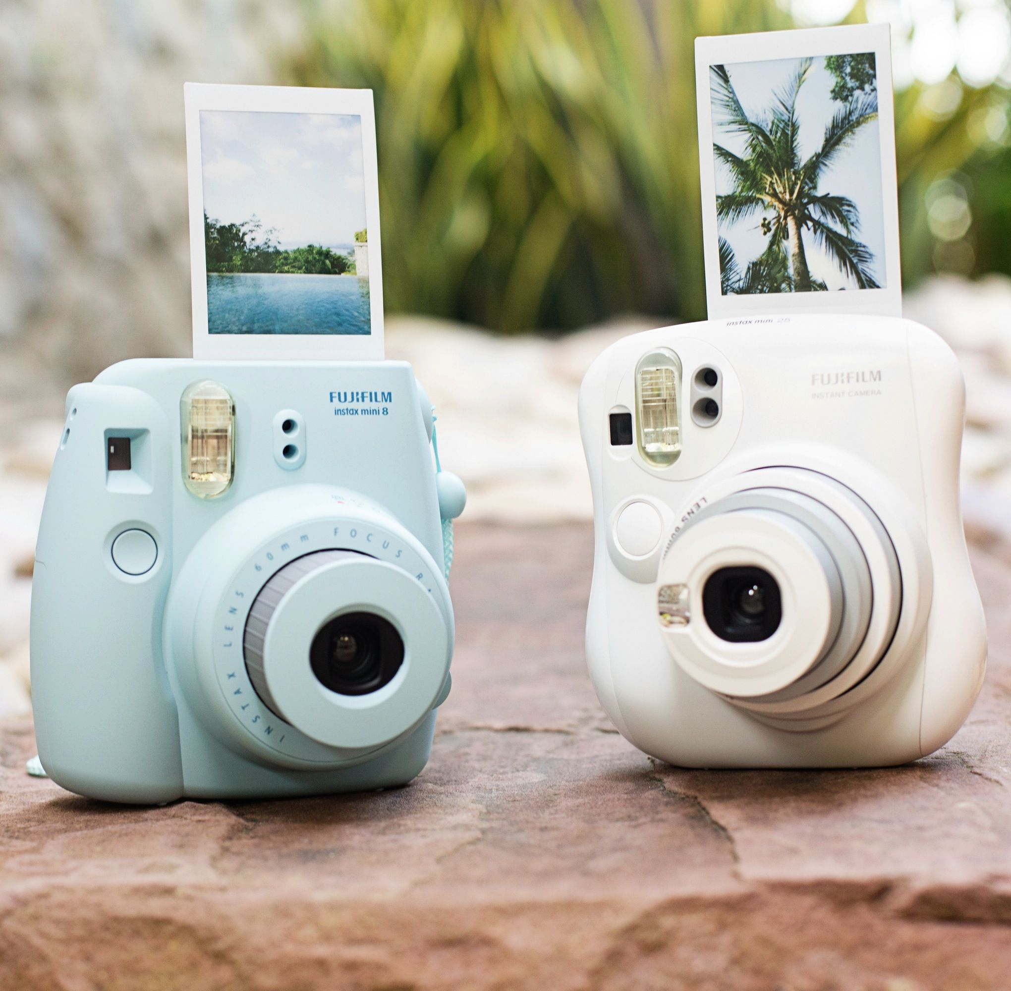 Instax Mini Instant Cameras - Make sharp, saturated, credit card-sized photos that develop instantly! The new (true blue) Mini 8 starts at $85