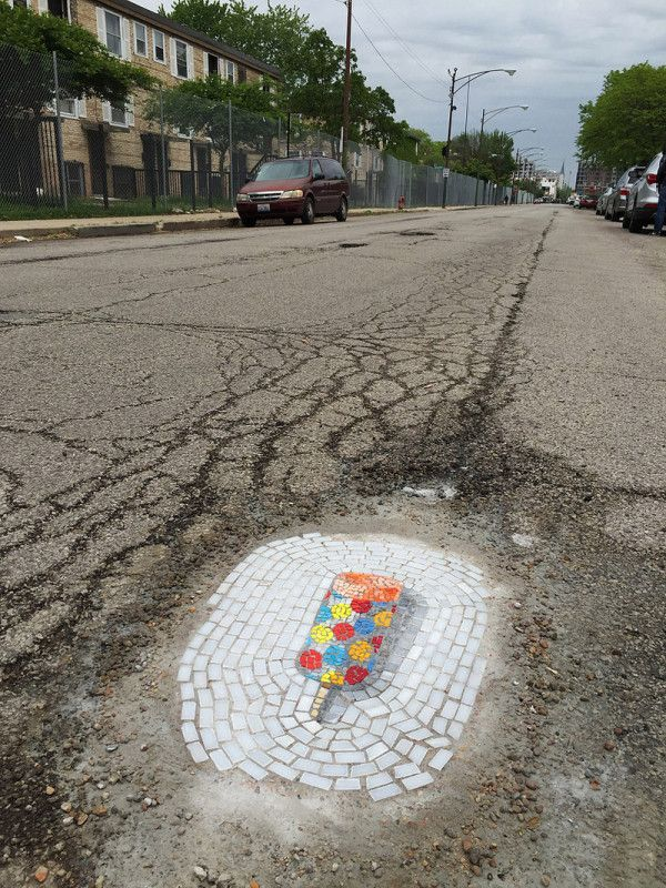 """Never thought we'd associate the word pothole with delicious, but there's a first for everything. Mosaic artist Jim Bachor is taking on the unique project of filling potholes and turning them into tasty works of art, appropriately named """"Treats in the Streets."""""""