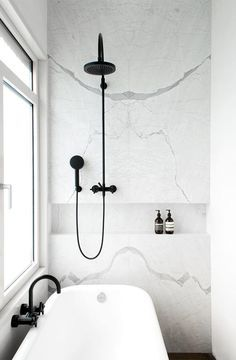 Matte black hardware with white marble