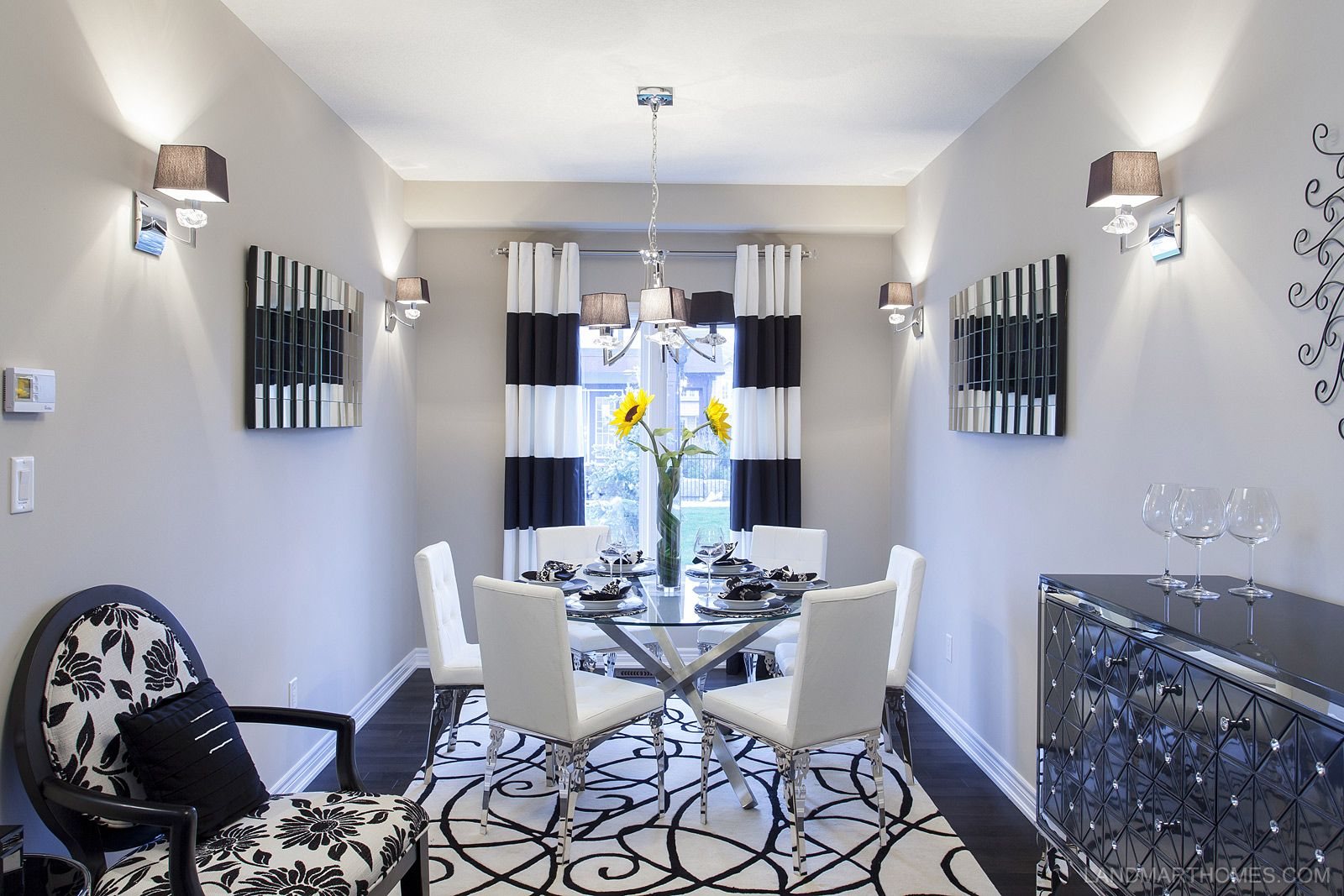 The depth of this dining room combined with its modern design give it a  striking look. Penny Lane Estates in Stoney Creek, Ontario. By Landmart  Homes.