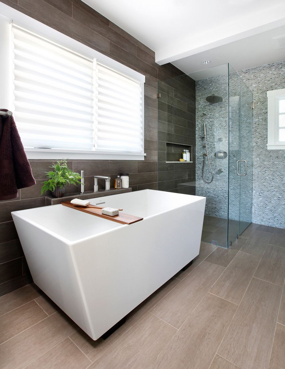 Clean lines and a curbless shower help give this bathroom a spa-like ...
