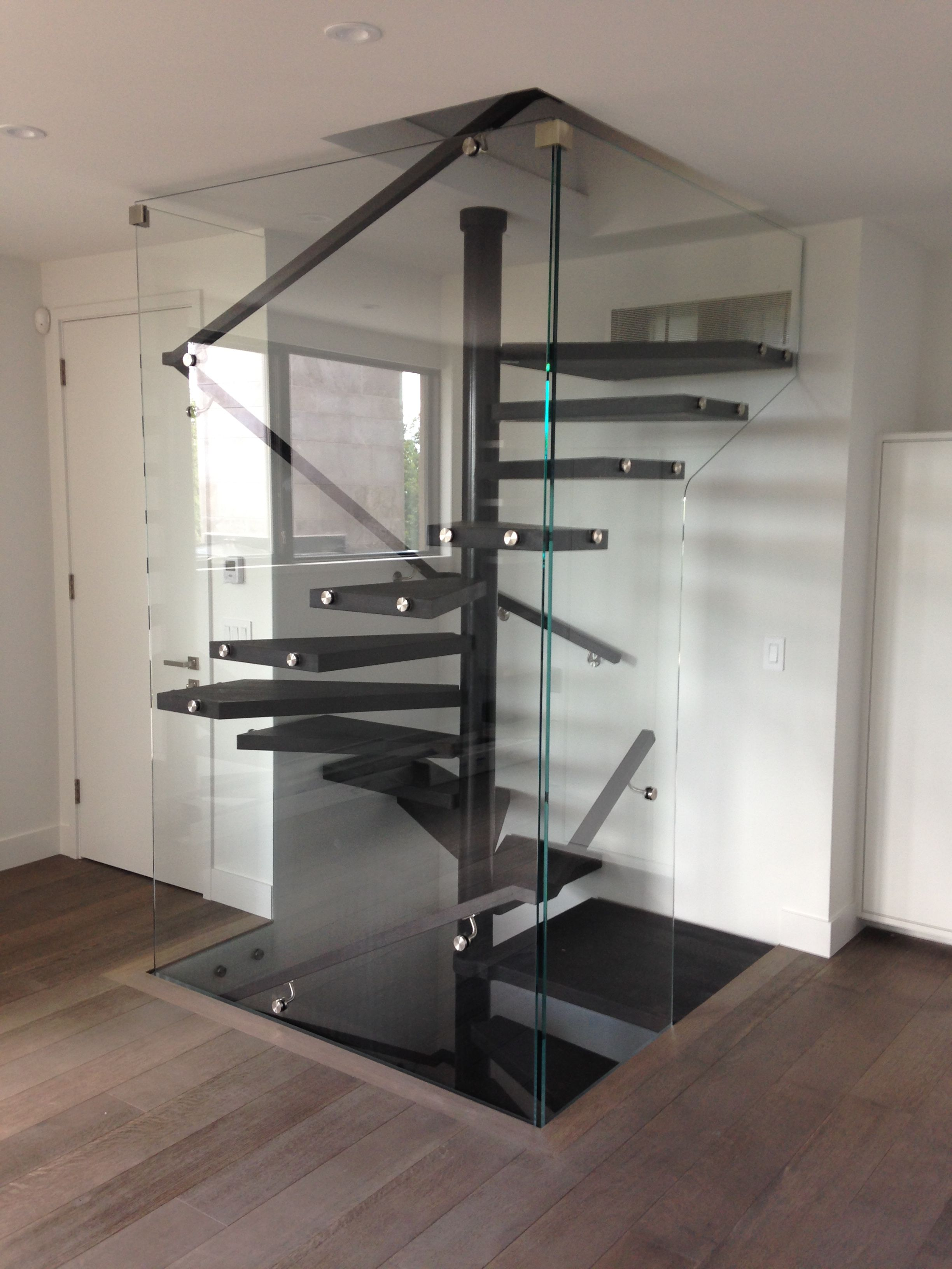 enclosed floating square spiral staircase | Staircase in