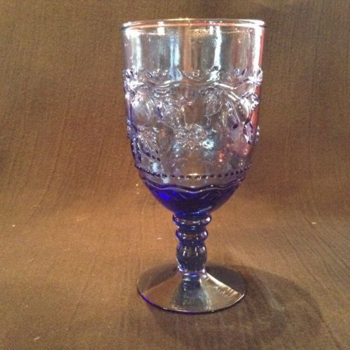 Vintage set of eight water glasses with pressed grape design