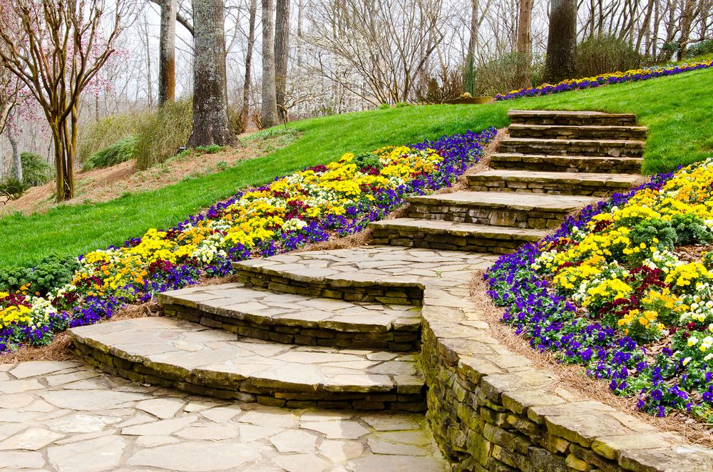 What Can A Retaining Wall Do For Your Landscape Adc Hardscapes Retaining Wall Contractor In Oklahoma City Edmond Ok Landscape Design Landscape Edging Traditional Landscape