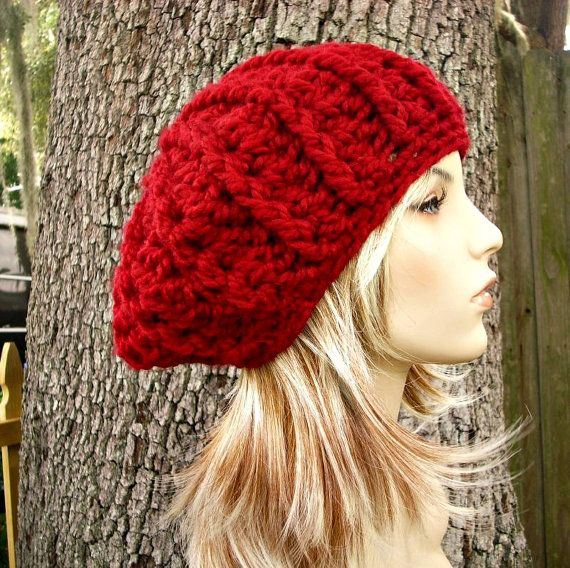 6284e3a8522 This slightly oversized cozy ribbed beret is hand crocheted in a wool blend  yarn in a striking cranberry red colour. It features a ribbed pattern that
