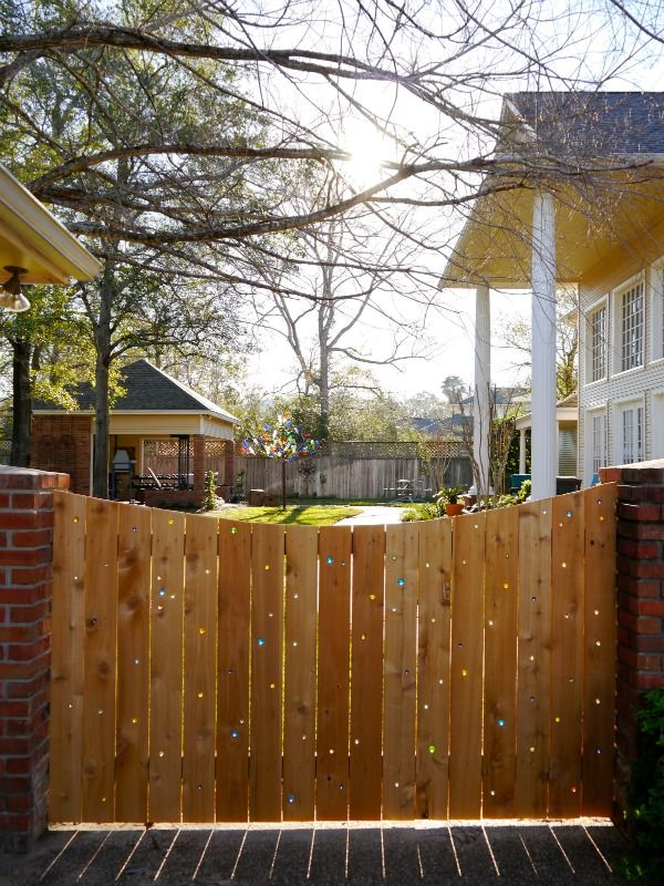 s 15 privacy fences that will turn your yard into a secluded oasis curb appeal fences drill holes in a plain fence to add marbles