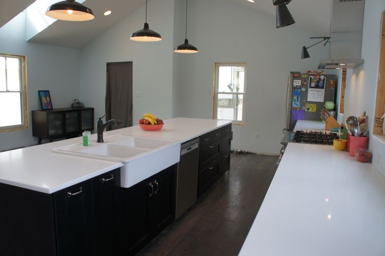 white countertops and farm sink