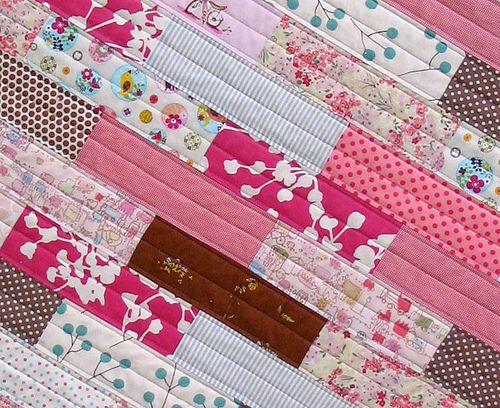 """pretty in pink quilt, 38x44"""", made with 18 rows of 3x9"""" bricks.  nice quilting too...easy peasy"""