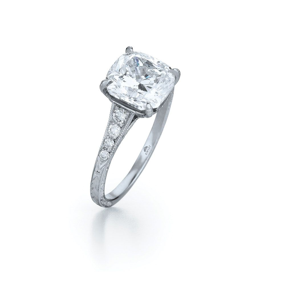 Cushion diamond ring in platinum with a graduating pave diamond and