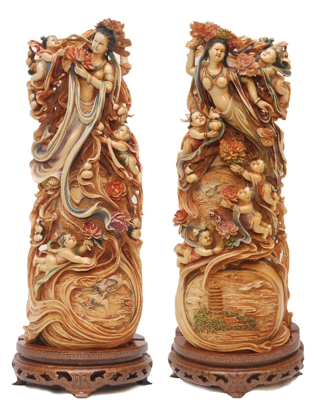 A pair of chinese fully relief carved and polychromed interlocking