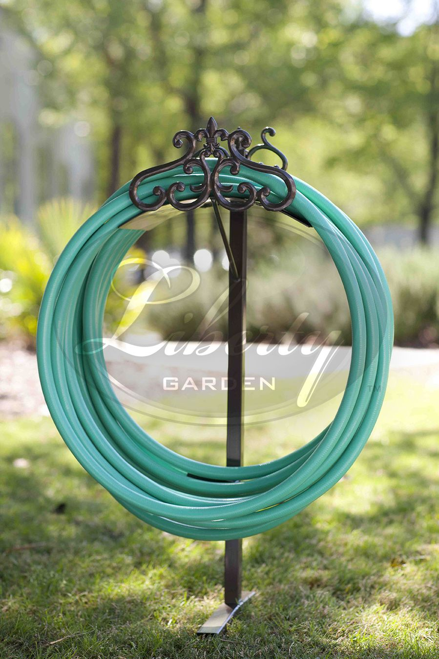 The Hyde Park Decorative Hose Stand compliments any lawn