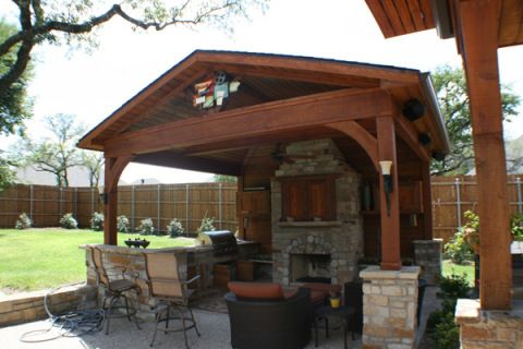 Freestanding Covered Patio With Outdoor Fireplace And Built In