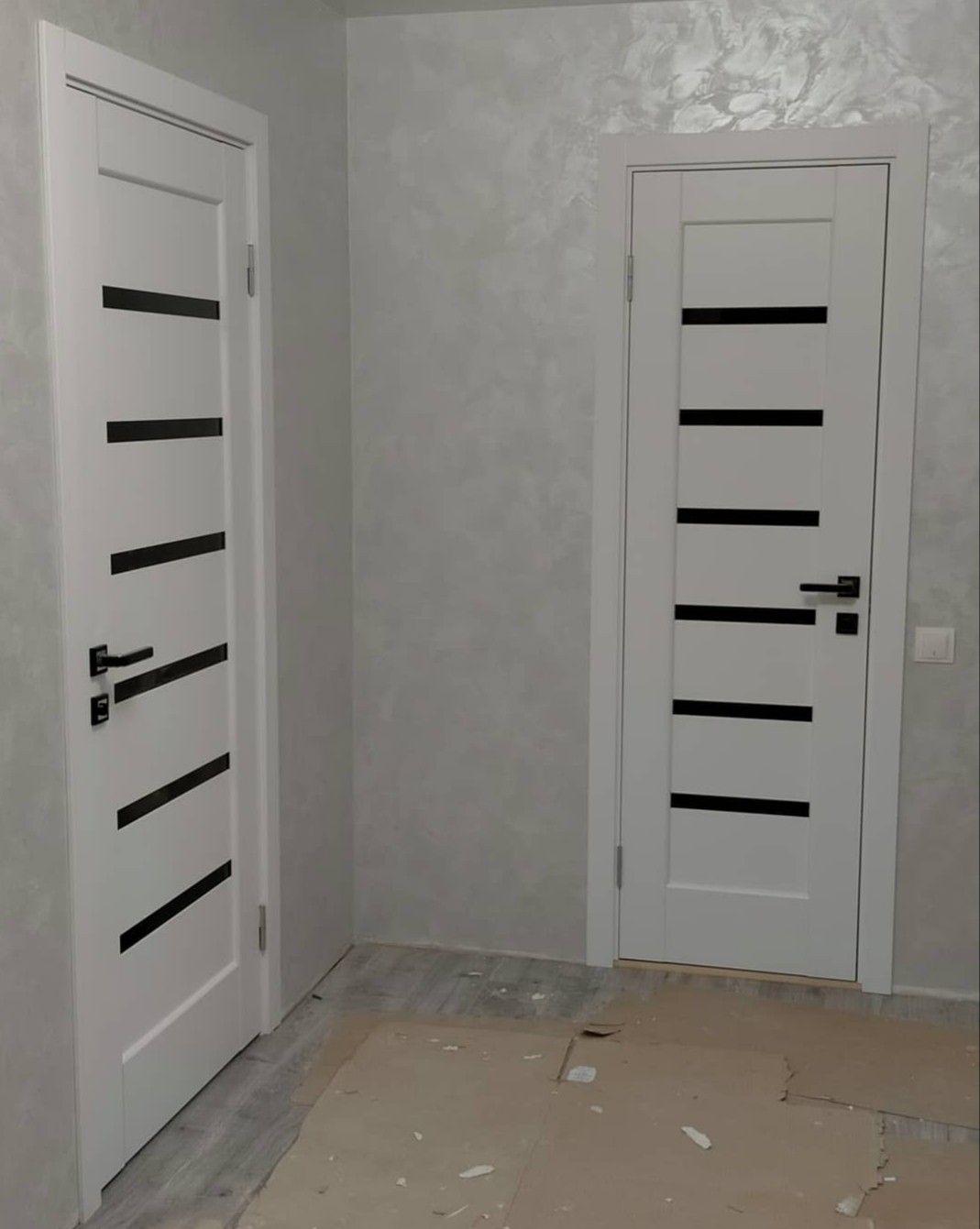 Білі  двері в інтер'єрі. Е-монтаж-служба замірів монтажу під…