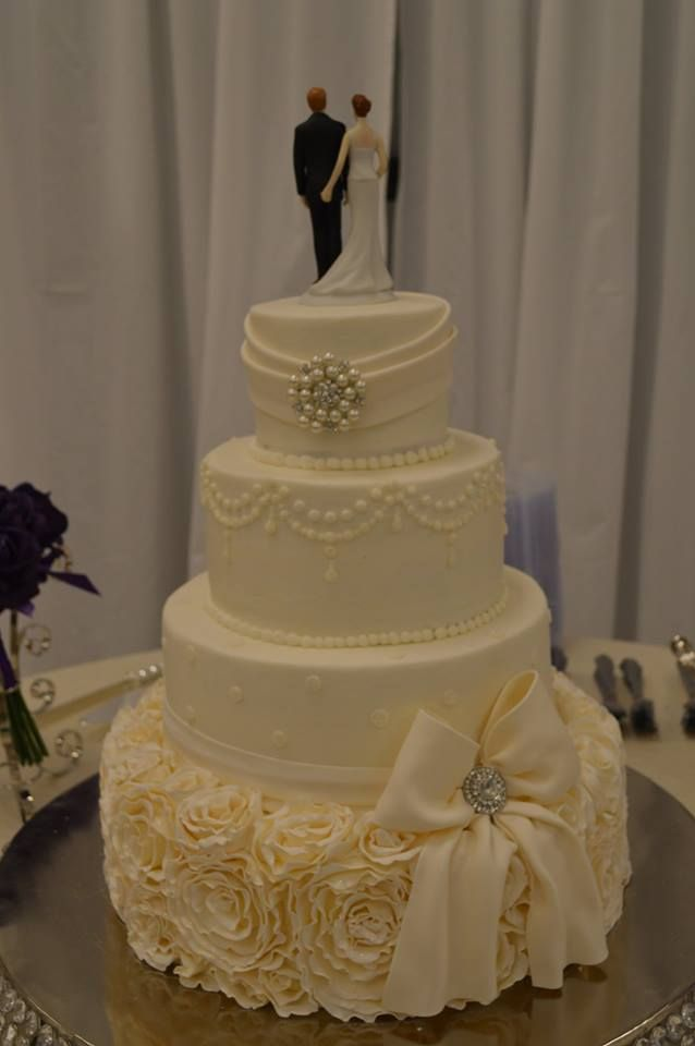 wedding cake with bow wedding cake ruffle rosettes bow created by cakes by 26833
