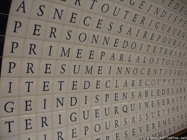 """Tunnel for line 12 in the Concorde station (Paris Métro) featuring tiles spelling out Déclaration des droits de l'homme et du citoyen (or The Declaration of the Rights of Man and the Citizen) a fundamental document for the French Revolution and human rights. The station itself was the  inspiration for Ezra Pound's poem """"In a station of the Metro."""""""