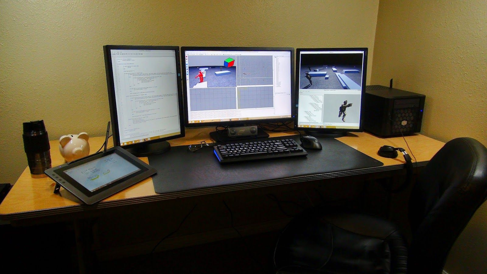 a triple monitor setup that has both landscape and two portrait