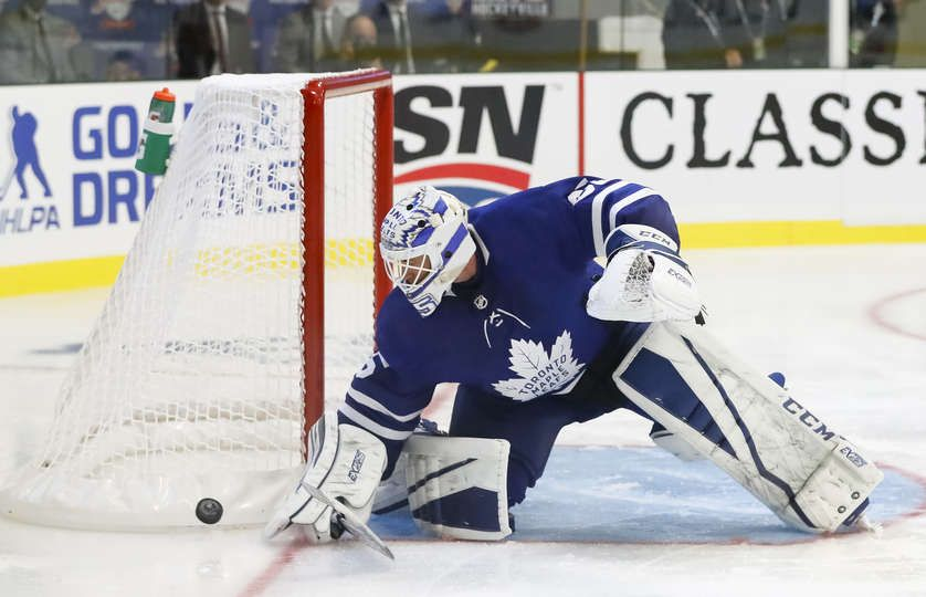 LUCAN, ON - SEPTEMBER 18: Curtis Mcelhinney #35 of the Toronto Maple Leafs makes a blocker save during a preseason game against the Ottawa Senators during Kraft Hockeyville Canada at the Lucan Community Memorial Centre on September 18, 2018 in Lucan, Ontario, Canada. (Photo by Mark Blinch/NHLI via Getty Images)