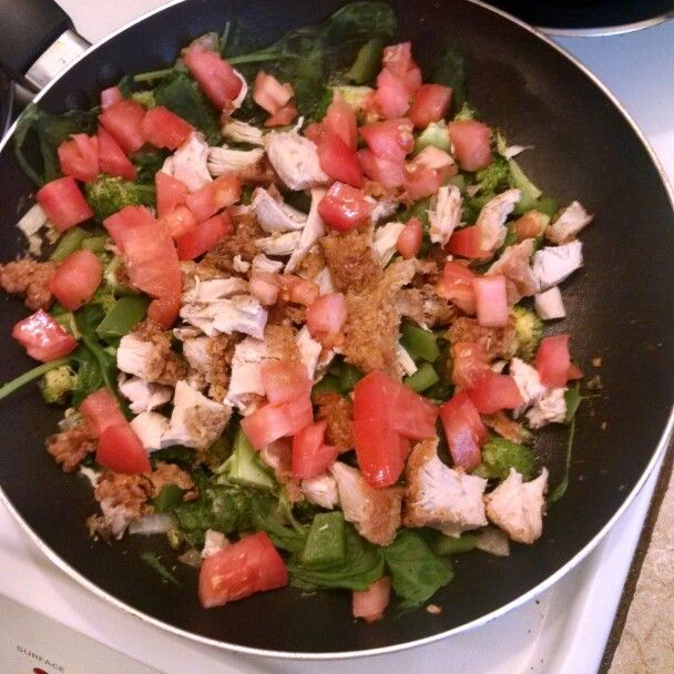 Broccoli, spinach, green bell pepper, tomatoes, onion, garlic, butter, and chicken.