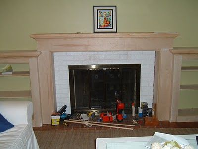 Short maple fire place with shelves.