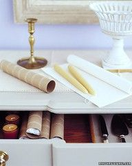 Candle Protectors by marthastewart: Wrap the candles in tissue paper & tuck into a cardboard roll. Label each tube w/ the candles' color 7 length.