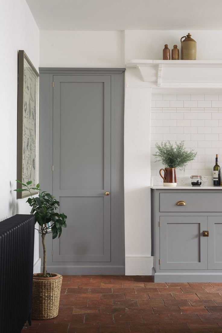 Off white kitchen cabinets with grey island and pics of whitewashed