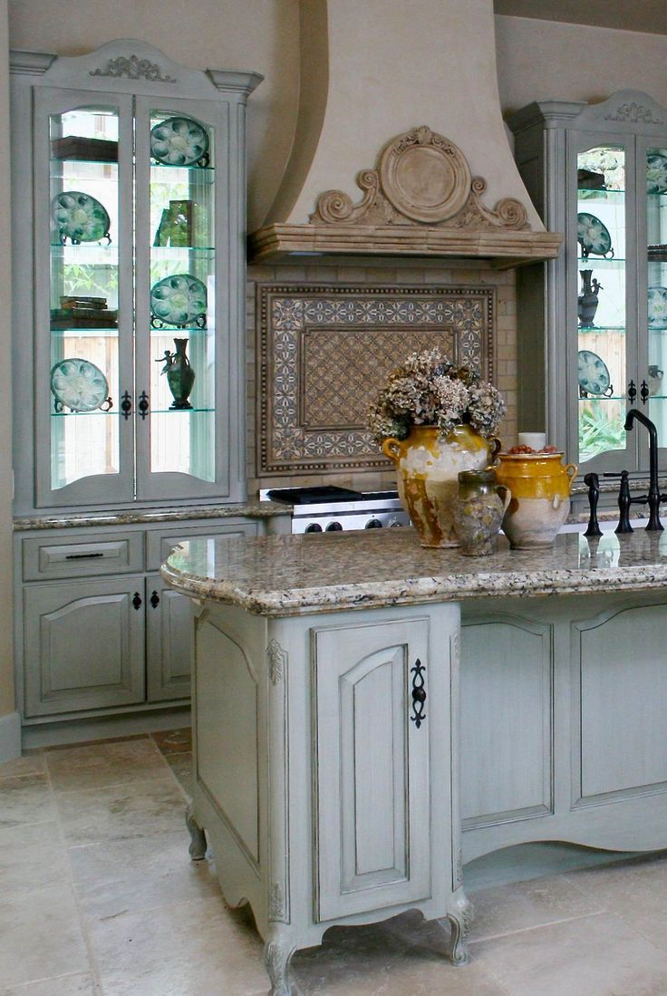 Nice French-style kitchen island. Love the shape of the granite top ...