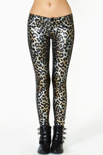 af1aefc23d3236 Prowl around in these super cool coated skinny jeans featuring a metallic  gold and silver leopard print. Front and back pockets, button/zip .