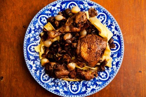 Classic French stewed chicken recipe, with bacon, mushrooms,  and pearl onions.