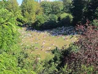 Learning how to NOT do work- and take photos. Buttes Chaumont, Paris. Busy summer day.