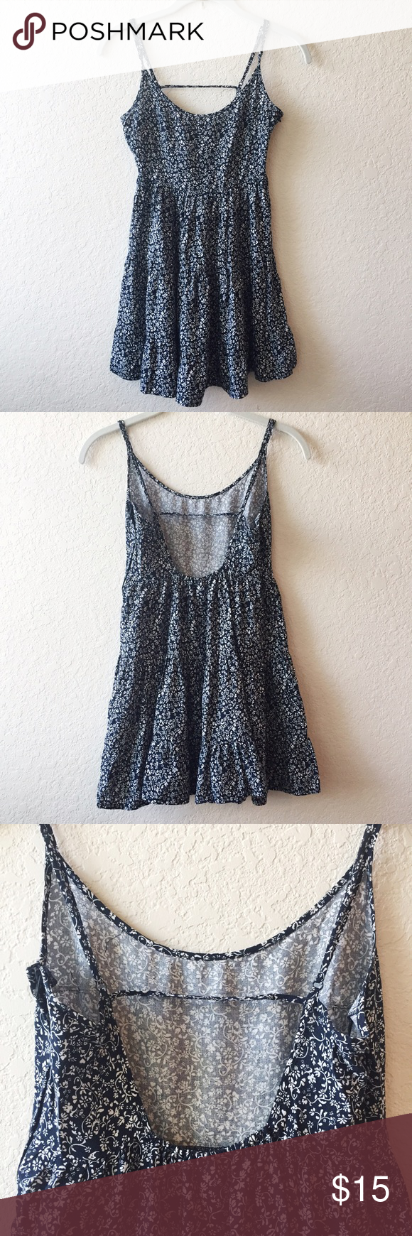 H&M Open-Back Smock Dress Hardly worn! Super cute navy dress with white floral print. Hidden side zipper, adjustable straps for desired length. A few stray strands of fabric (as shown in picture) but not noticeable because of the print. Love this because it looks like a Brandy Melville Jada dress, but it didn't fit me very comfortably on top (size 32D). Would be perfect for someone who is A-C. 100% viscose. H&M Dresses Mini
