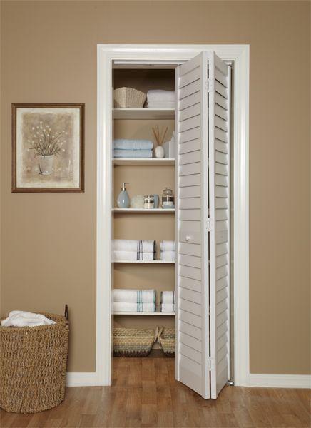 "Louvered Bifold Doors 3"" louver / louver bi-fold door in linen closet. gives your home a"